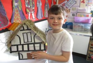 Boy with tudor house