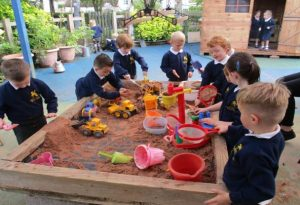 children playing with sand pit